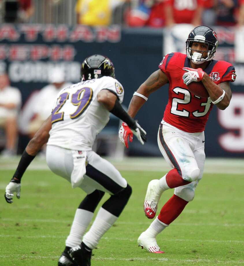 Houston Texans running back Arian Foster (23) runs the ball against Baltimore Ravens cornerback Cary Williams (29) during the second quarter at Reliant Stadium on Sunday, Oct. 21, 2012, in Houston. Photo: Brett Coomer, Houston Chronicle / © 2012  Houston Chronicle
