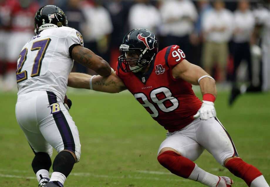 Houston Texans outside linebacker Connor Barwin (98) tries to stop Baltimore Ravens running back Ray Rice (27) during the second quarter at Reliant Stadium on Sunday, Oct. 21, 2012, in Houston. Photo: Brett Coomer, Houston Chronicle / © 2012  Houston Chronicle