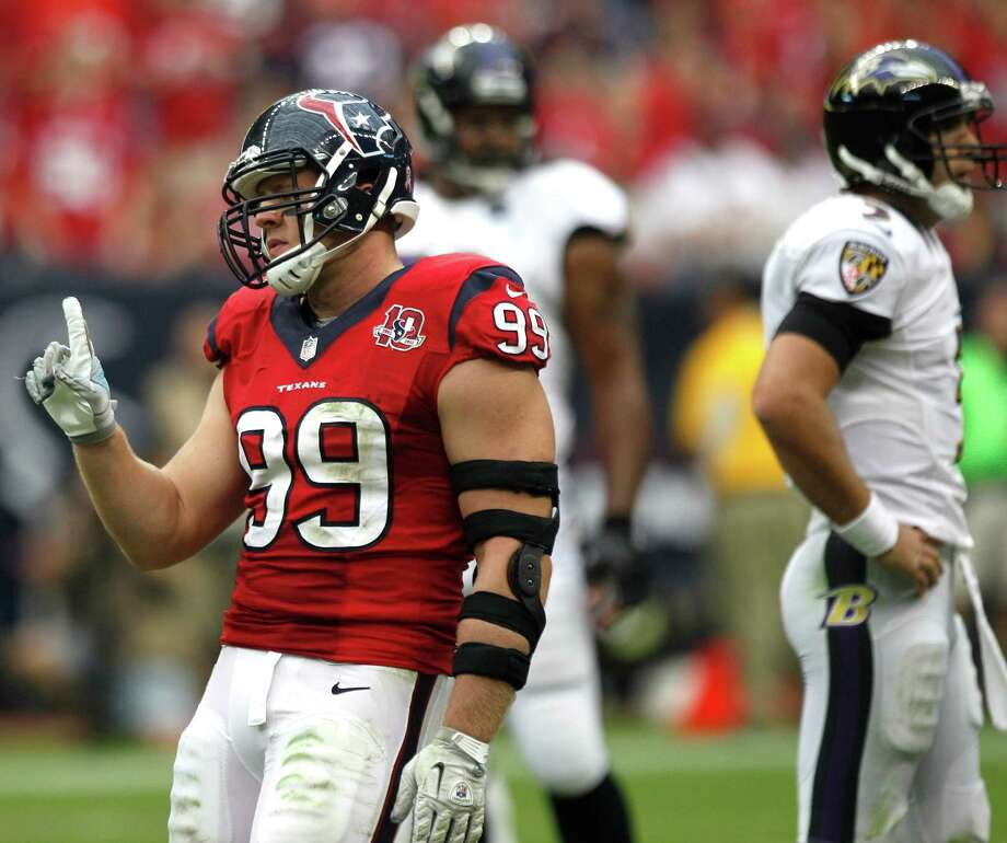 Houston Texans defensive end J.J. Watt (99) wags his finger after sacking Baltimore Ravens quarterback Joe Flacco (5) during the third quarter at Reliant Stadium on Sunday, Oct. 21, 2012, in Houston. The Texans beat the Ravens 43-13. Photo: Brett Coomer, Houston Chronicle / © 2012  Houston Chronicle