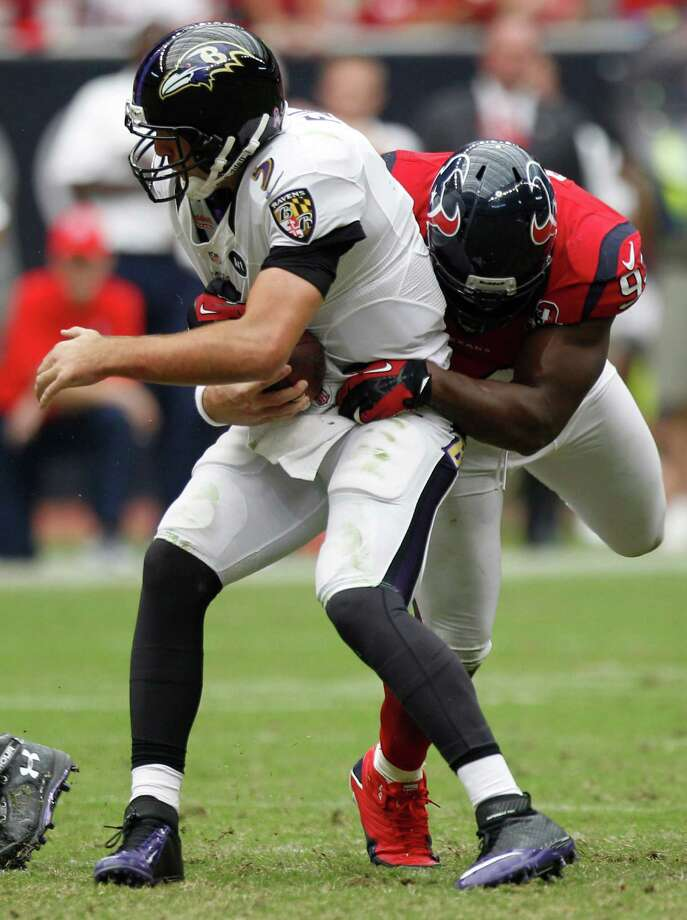 Baltimore Ravens quarterback Joe Flacco (5) is sacked by Houston Texans defensive end Antonio Smith (94) during the fourth quarter at Reliant Stadium on Sunday, Oct. 21, 2012, in Houston. The Texans beat the Ravens 43-13. Photo: Brett Coomer, H / © 2012  Houston Chronicle