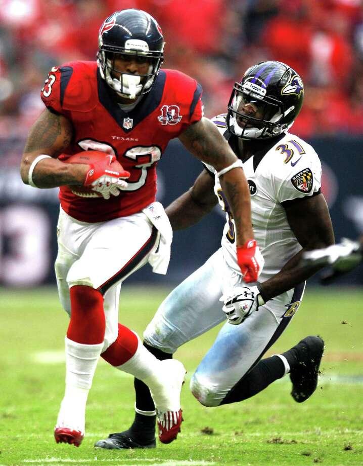 Houston Texans running back Arian Foster (23) runs past Baltimore Ravens strong safety Bernard Pollard (31) during the fourth quarter at Reliant Stadium on Sunday, Oct. 21, 2012, in Houston. The Texans beat the Ravens 43-13. Photo: Brett Coomer, H / © 2012  Houston Chronicle