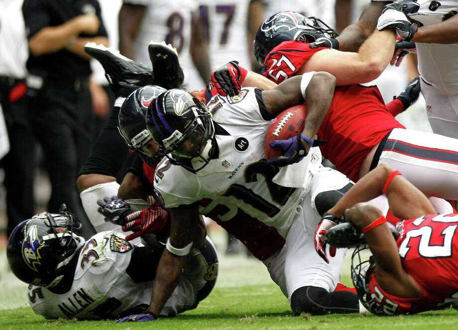 Baltimore Ravens wide receiver Jacoby Jones (12) is stopped by Houston Texans defensive back Alan Ball (22) on a kickoff retrun during the fourth quarter at Reliant Stadium on Sunday, Oct. 21, 2012, in Houston. Photo: Brett Coomer, H / © 2012  Houston Chronicle