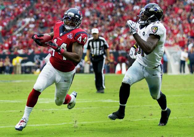 Houston Texans running back Ben Tate (44)] is chased down by Baltimore Ravens strong safety Bernard Pollard (31) during the fourth quarter at Reliant Stadium on Sunday, Oct. 21, 2012, in Houston. The Texans beat the Ravens 43-13. Photo: Brett Coomer, H / © 2012  Houston Chronicle