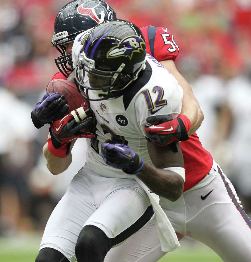 Baltimore Ravens wide receiver Jacoby Jones (12) is tackled by Houston Texans linebacker Bryan Braman (50) during the second quarter of an NFL football game, Sunday, Oct. 21, 2012, at Reliant Stadium in Houston. Photo: Nick De La Torre, Houston Chronicle / © 2012  Houston Chronicle
