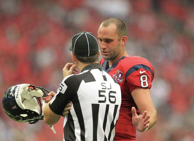 Houston Texans quarterback Matt Schaub (8) chats with side judge Allen Baynes (56) during the fourth quarter of an NFL football game at Reliant Stadium, Sunday, Oct. 21, 2012, in Houston. Texans won 43-13. Photo: Karen Warren, Houston Chronicle / © 2012  Houston Chronicle