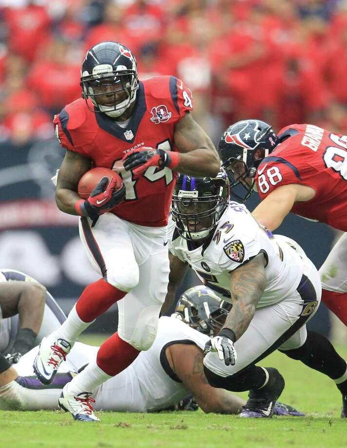 Houston Texans running back Ben Tate (44) runs the ball during the fourth quarter of an NFL football game at Reliant Stadium, Sunday, Oct. 21, 2012, in Houston. Texans won 43-13. Photo: Karen Warren, Houston Chronicle / © 2012  Houston Chronicle
