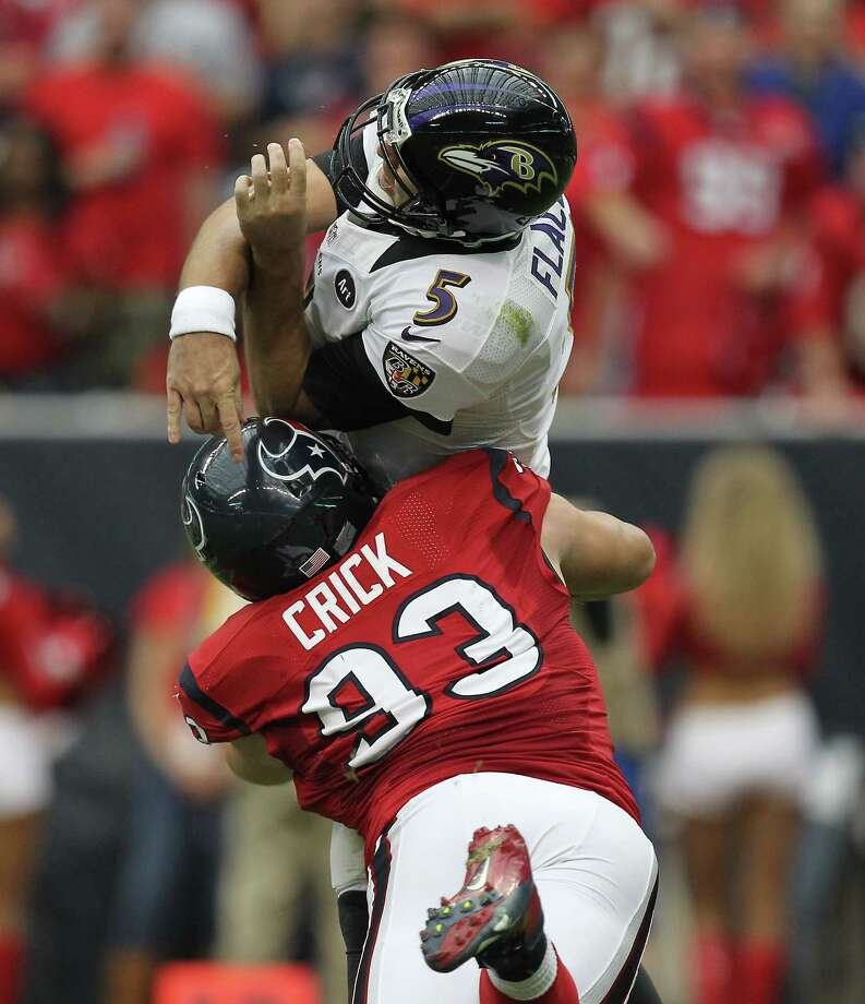 Houston Texans defensive end Jared Crick (93) hits Baltimore Ravens quarterback Joe Flacco (5) just after Flacco released the ball during the second quarter of an NFL football game, Sunday, Oct. 21, 2012, at Reliant Stadium in Houston. Photo: Nick De La Torre, Houston Chronicle / © 2012  Houston Chronicle