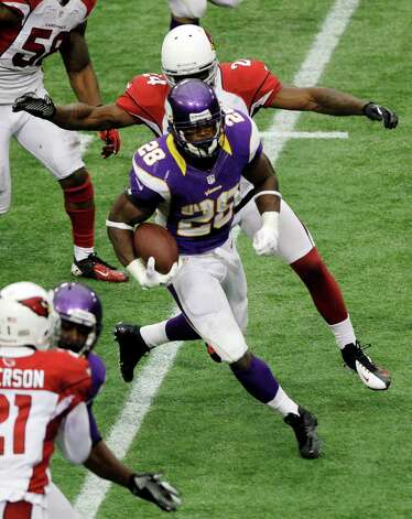 Minnesota Vikings running back Adrian Peterson (28) rushes against Arizona Cardinals strong safety Adrian Wilson (24)in the second half in Minneapolis, Sunday, Oct. 21, 2012. Photo: Kiichiro Sato, Associated Press / AP