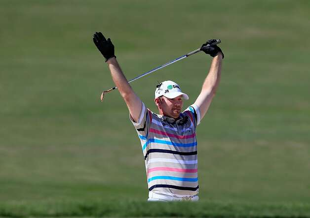 Tommy Gainey hails his eagle on No. 15. Photo: Sam Greenwood, Getty Images