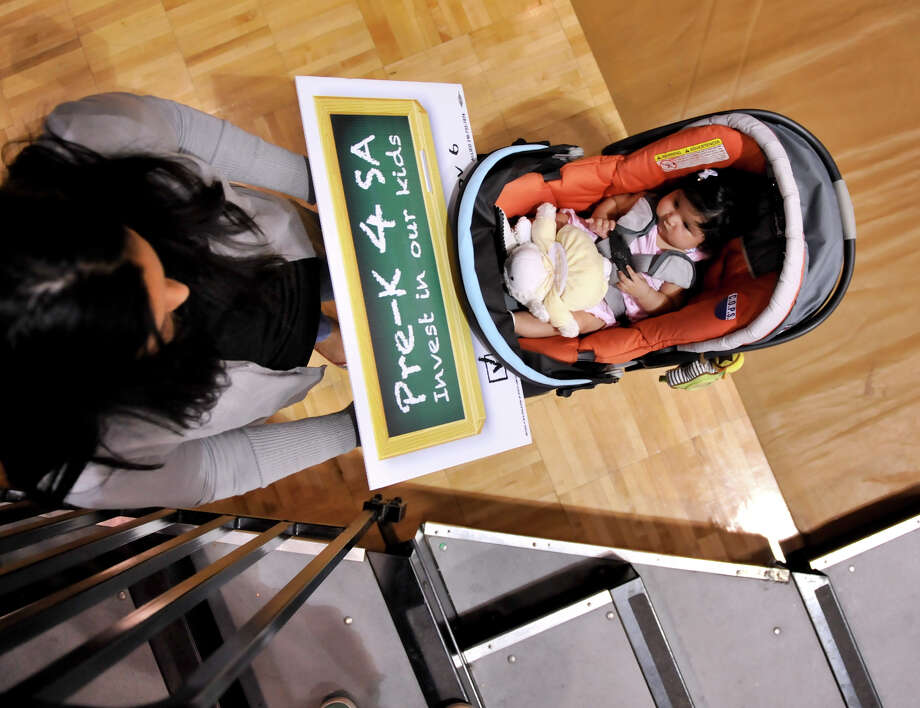 Sofia Avina, 4 months, attended the METRO/COPS Fall Gathering at St. Mary's University Sunday afternoon with her mother, Lolita Avina. Her stroller carried a sign supporting the Pre-K initiative. Photo: For The Express-News