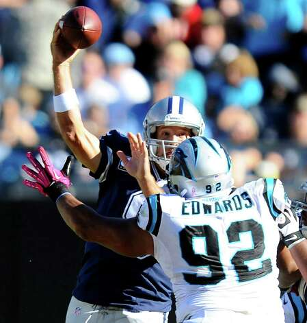 Dallas Cowboys' Tony Romo (9) gets pressured by Carolina Panthers' Dwan Edwards (92) in the second half at Bank of America Stadium in Charlotte, North Carolina on Sunday, October 21, 2012. The Dallas Cowboys defeated the Carolina Panthers, 19-14. (David T. Foster III/Charlotte Observer/MCT) Photo: David T. Foster III, McClatchy-Tribune News Service / Charlotte Observer