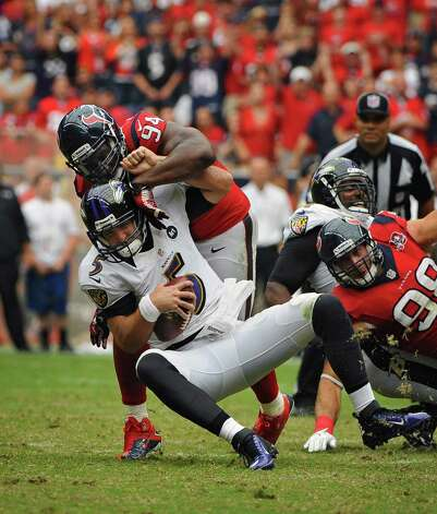 Baltimore Ravens quarterback Joe Flacco (5) is sacked by Houston Texans' Antonio Smith for a loss of eight yards in the fourth quarter at Reliant Stadium on Sunday, October 21, 2012, in Houston, Texas. The Houston Texans defeated the Baltimore Ravens, 34-13. (Kenneth K. Lam/Baltimore Sun/MCT) Photo: Kenneth K. Lam, McClatchy-Tribune News Service / Baltimore Sun
