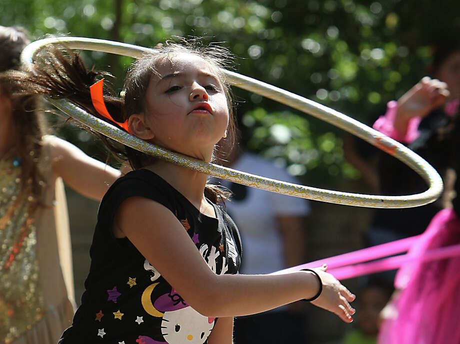 Hula-hoop. Same as the jump rope. Load it up with LEDs! Photo: James Nielsen, Chronicle / © Houston Chronicle 2012