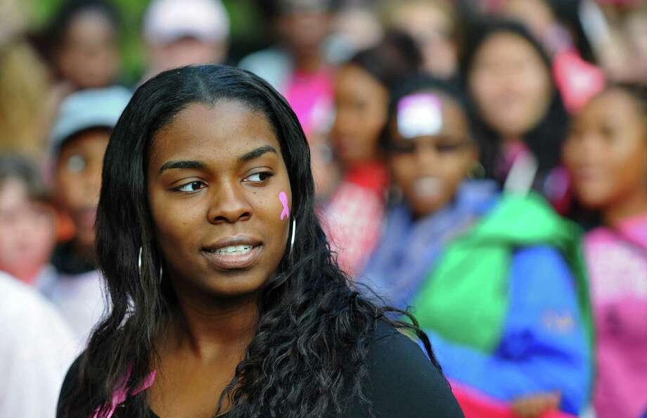 Sade Gordon of Brooklyn, a College of St. Rose student, walks in Washington Park during the Making Strides Against Breast Cancer walk on Sunday Oct. 21, 2012 in Albany, NY.  A close friend of her family was just diagnosed with stage 3 breast cancer. Over 15, 000 people walked through the park, raising over $1 million, according to Rebecca Colino of the American Cancer Society. (Philip Kamrass /  Times Union) Photo: Philip Kamrass / 00019712A