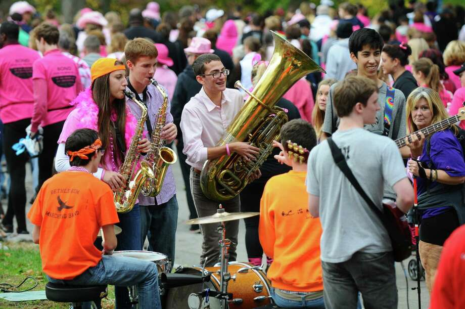 Members of the Bethlehem (High School ) Hooligans pep band serenade walkers in Washington Park during the Making Strides Against Breast Cancer walk on Sunday Oct. 21, 2012 in Albany, NY.  Over 15, 000 people walked through the park, raising over $1 million, according to Rebecca Colino of the American Cancer Society. (Philip Kamrass /  Times Union) Photo: Philip Kamrass / 00019712A