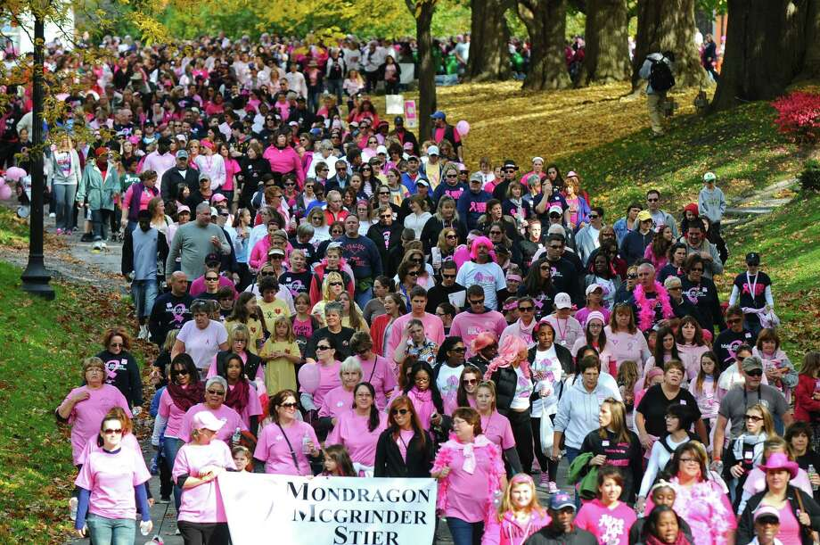 Some of over 15, 000 walkers make their way through Washington Park during the Making Strides Against Breast Cancer walk on Sunday Oct. 21, 2012 in Albany, NY.  Over 15, 000 people walked 3.2 miles through the park, raising over $1 million, according to Rebecca Colino of the American Cancer Society. (Philip Kamrass /  Times Union) Photo: Philip Kamrass / 00019712A