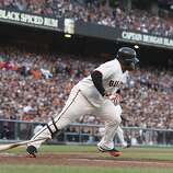 Giants' third baseman Pablo Sandoval singles in the 2nd inning to score Marco Scutaro during the NLCS game 6 at AT&T Park in San Francisco, Calif., on Sunday, Oct. 21, 2012.