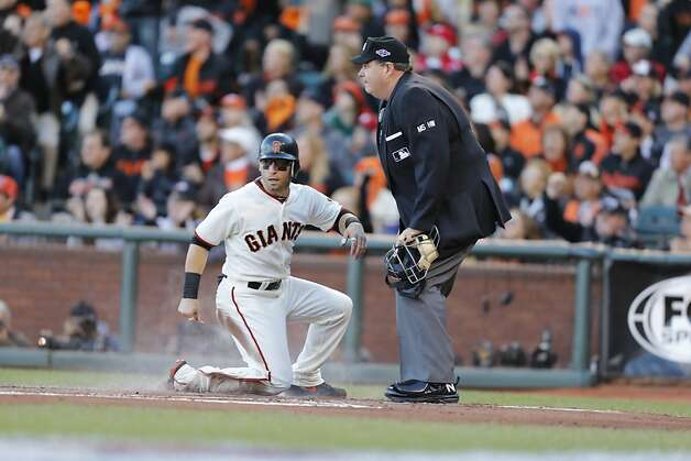 Giants' second baseman Marco Scutaro scores in the first inning off a Buster Posey sacrifice during game 2 of the NLCS at AT&T Park on Monday, Oct. 15, 2012 in San Francisco, Calif. Photo: Michael Macor, The Chronicle