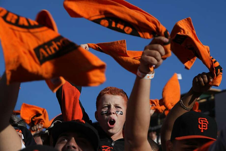"Ruben Davis, 14, of Lodi cheers as the Giants take the field for Game 6 of the NLCS against the Cardinals. ""This place gets loud, very loud,"" said Giants reliever Sergio Romo after the game. Photo: Pete Kiehart, The Chronicle"