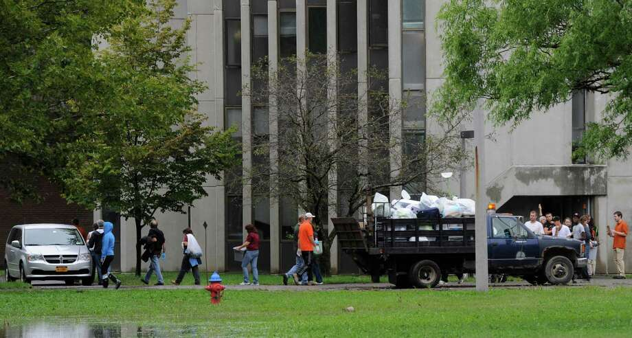 Students remove belongings from a dormitory on due to flooding on the SUNY Cobleskill, N.Y. campus September 8, 2011.  (Skip Dickstein/ Times Union) Photo: Skip Dickstein / 2011