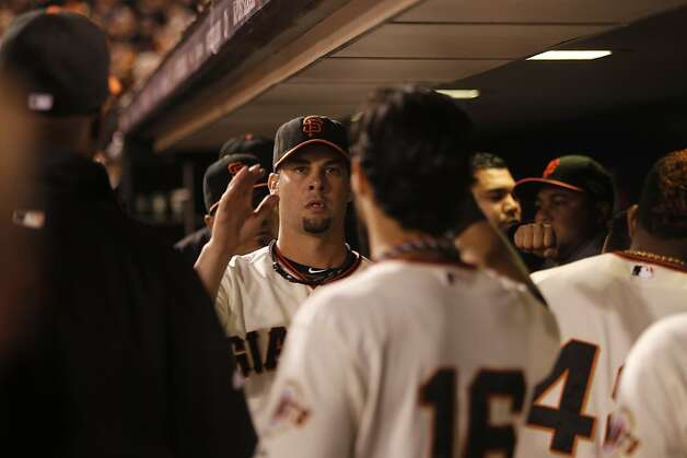 Giants' pitcher Ryan Vogelsong is greeted in the dugout  during game 6 of the NLCS at AT&T Park on Sunday, Oct. 21, 2012 in San Francisco, Calif. Photo: Michael Macor, The Chronicle