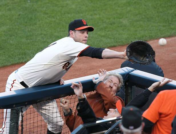 Giants' first baseman Brandon Belt tries to catch a foul ball in the 3rd inning during game 6 of the NLCS at AT&T Park on Sunday, Oct. 21, 2012 in San Francisco, Calif. Photo: Lance Iversen, The Chronicle
