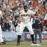 Giants' first baseman Brandon Belt hit a triple to start off a 2nd inning rally during the NLCS game 6 at AT&T Park in San Francisco, Calif., on Sunday, Oct. 21, 2012.