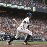 Giants' first baseman Brandon Belt hits a triple in the 2nd inning during the NLCS game 6 at AT&T Park in San Francisco, Calif., on Sunday, Oct. 21, 2012.