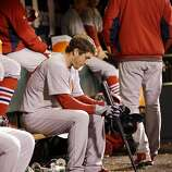 St. Louis Cardinals' David Freese waits to bat during the eighth inning of Game 6 of baseball's National League championship series against the San Francisco Giants Sunday, Oct. 21, 2012, in San Francisco. (AP Photo/David J. Phillip)