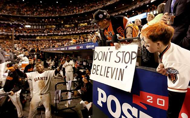 The Giants' Pablo Sandoval, (left) begins the celebration in front of fans, John CHasy, Ryan and Jack Scadina, (right) as the San Francisco Giants beat the St. Louis Cardinals 6-1 in game six of the National League Championship Series, on Sunday Oct. 21, 2012 at AT&T Park, in  San Francisco, Calif. Photo: Michael Macor, The Chronicle
