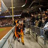 Eric Sanchez, of San Francisco, rallies the bleachers during the ninth inning of the National League Championship Series on Sunday, October 21, 2012 in San Francisco, Calif.