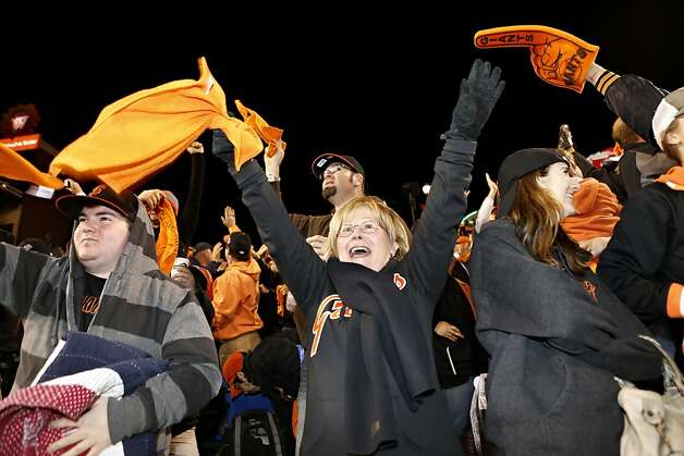 Carrie Hamer, of Stockton, celebrates after the San Francisco Giants defeated the St. Louis Cardinals in game six of the National League Championship Series on Sunday, October 21, 2012 in San Francisco, Calif. Photo: Beck Diefenbach, Special To The Chronicle