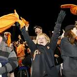 Carrie Hamer, of Stockton, celebrates after the San Francisco Giants defeated the St. Louis Cardinals in game six of the National League Championship Series on Sunday, October 21, 2012 in San Francisco, Calif.