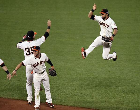 San Francisco Giants left fielder Gregor Blanco leaps into the air in celebration of the Giants 6-1 win over the St. Louis Cardinals in game six of the NLCS at AT&T Park on Sunday, Oct. 21, 2012 in San Francisco, Calif. Photo: Lance Iversen, The Chronicle