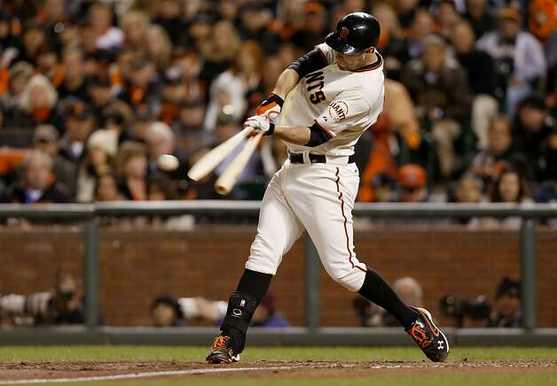 Giants' Brandon Belt shattered his bat in the eighth innning but still singled, as the San Francisco Giants beat the St. Louis Cardinals 6-1 in game six of the National League Championship Series, on Sunday Oct. 21, 2012 at AT&T Park, in  San Francisco, Calif. Photo: Michael Macor, The Chronicle