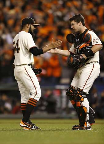 Giants' closing pitcher, Sergio Romo, (left) and catcher Buster Posey, celebrate, as the San Francisco Giants beat the St. Louis Cardinals 6-1 in game six of the National League Championship Series, on Sunday Oct. 21, 2012 at AT&T Park, in  San Francisco, Calif. Photo: Michael Macor, The Chronicle
