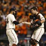 Giants' closing pitcher, Sergio Romo, (left) and catcher Buster Posey, celebrate, as the San Francisco Giants beat the St. Louis Cardinals 6-1 in game six of the National League Championship Series, on Sunday Oct. 21, 2012 at AT&T Park, in  San Francisco, Calif.