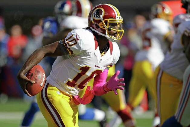 Washington Redskins quarterback Robert Griffin III (10) rushes during the first half of an NFL football game against the New York Giants Sunday, Oct. 21, 2012 in East Rutherford, N.J. (AP Photo/Kathy Willens) Photo: Kathy Willens