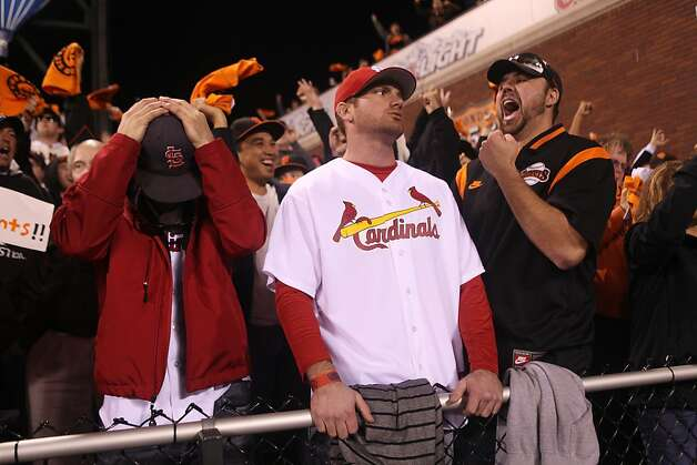 Gavin Owsley, (l-r) Jared Owsley, and Rob Coleman react Game 6 of the NLCS between the San Francisco Giants and the St. Louis Cardinals at AT&T Park Sunday, October 21, 2012 in San Francisco, Calif. The three friends traveled to the game from Nevada. Photo: Pete Kiehart, The Chronicle