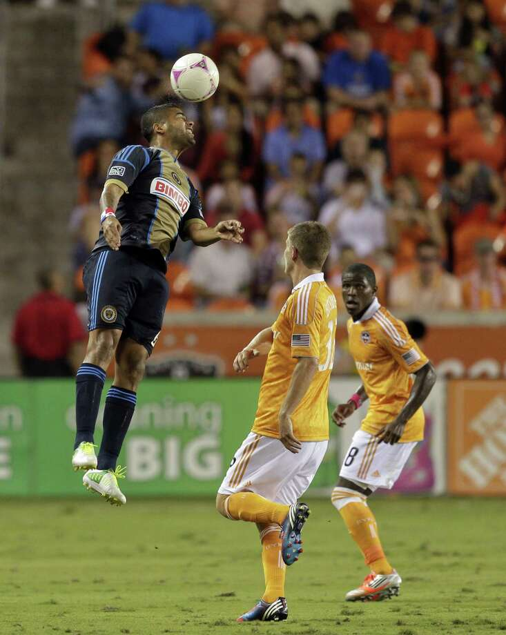HOUSTON,TX - OCTOBER 20: Gabriel Gomez #6 of the Philadelphia Union heads the ball away from Bobby Boswell #32 and Kofi Sarkodie #8 of the Houston Dynamo in the second half at BBVA Compass Stadium on October 20, 2012 in Houston, Texas. Houston won 3-1. Photo: Bob Levey, Getty Images / 2012 Getty Images