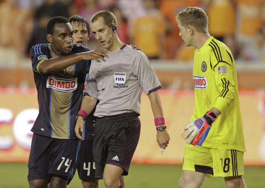 HOUSTON,TX - OCTOBER 20:  Amobi Okugo #14 of the Philadelphia Union pleads with referee Mark Geiger as goalkeeper Zac MacMath #18 of the Philadelphia Union looks on after a penalty kick was given to the Houston Dynamo at BBVA Compass Stadium on October 20, 2012 in Houston, Texas. Houston won 3-1. Photo: Bob Levey, Getty Images / 2012 Getty Images