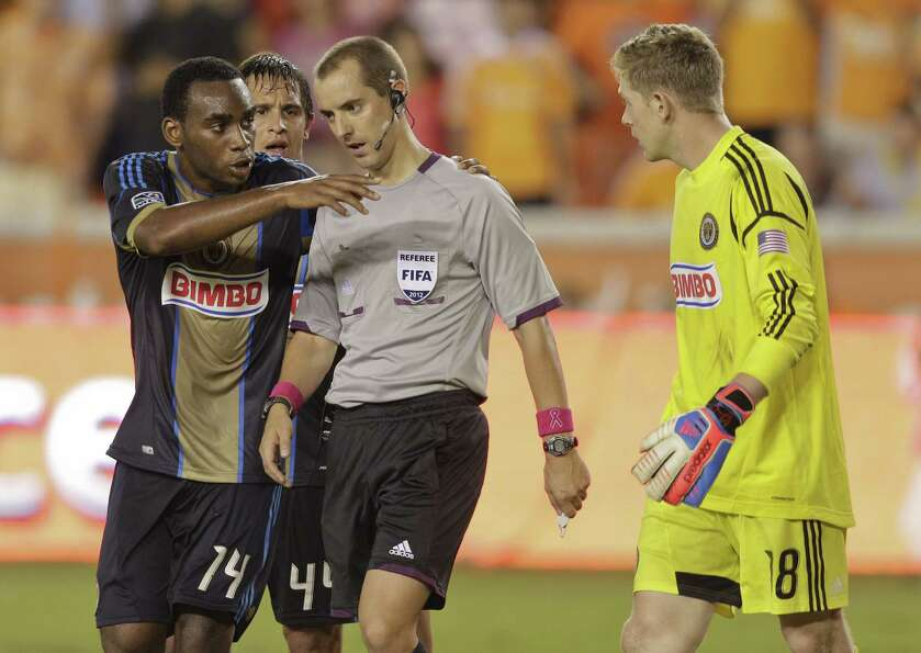 HOUSTON,TX - OCTOBER 20:  Amobi Okugo #14 of the Philadelphia Union pleads with referee Mark Geiger