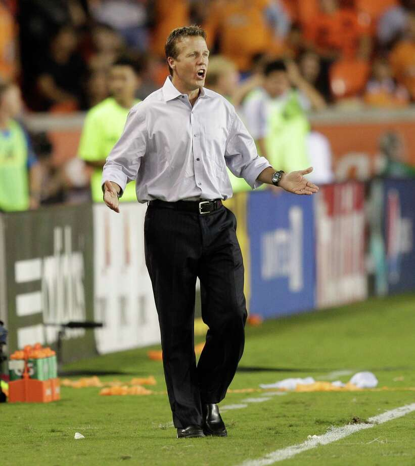 HOUSTON,TX - OCTOBER 20:  Head coach John Hackworth of the Philadelphia Union questions the referee's call of a penalty kick for the Houston Dynamo in the second half at BBVA Compass Stadium on October 20, 2012 in Houston, Texas. Houston won 3-1. Photo: Bob Levey, Getty Images / 2012 Getty Images