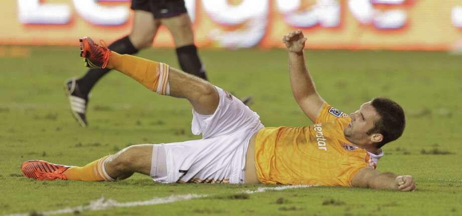 HOUSTON,TX - OCTOBER 20: Will Bruin #12 of the Houston Dynamo is taken down in the box buy Carlos Valdes #2 of the Philadelphia Union in the second half which lead to a penalty kick at BBVA Compass Stadium on October 20, 2012 in Houston, Texas. Houston won 3-1. Photo: Bob Levey, Getty Images / 2012 Getty Images