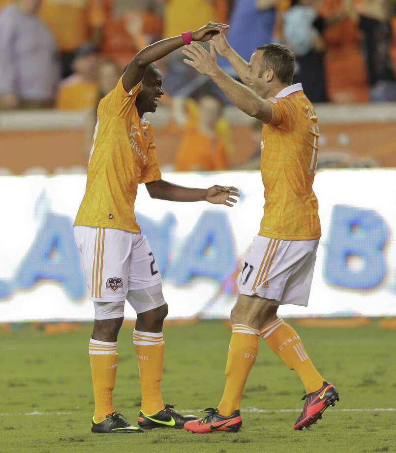 HOUSTON,TX - OCTOBER 20:  Boniek Garcia #27 celebrates his goal with Brad Davis #11 of the Houston Dynamo against the Philadelphia Union in the second half at BBVA Compass Stadium on October 20, 2012 in Houston, Texas. Houston won 3-1. Photo: Bob Levey, Getty Images / 2012 Getty Images