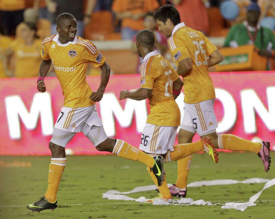 HOUSTON,TX - OCTOBER 20: Boniek Garcia #27 celebrates his score in the second half against the Philadelphia Union with Brian Ching #25 and Boniek Garcia #27 of the Houston Dynamo at BBVA Compass Stadium on October 20, 2012 in Houston, Texas. Houston won 3-1. Photo: Bob Levey, Getty Images / 2012 Getty Images