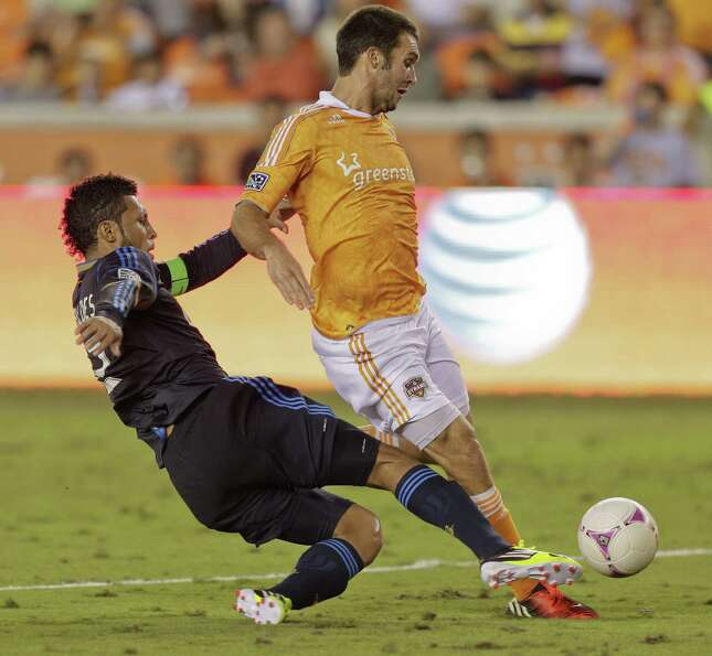 HOUSTON,TX - OCTOBER 20: Will Bruin #12 of the Houston Dynamo is taken down in the box buy Carlos Va