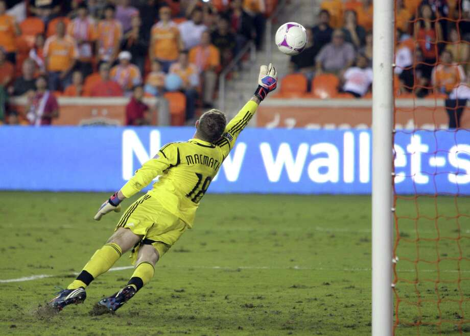 HOUSTON,TX - OCTOBER 20: Zac MacMath #18 of the Philadelphia Union dives but can't stop the shot from Boniek Garcia #27 of the Houston Dynamo from going to the back of the net for a score in the second half at BBVA Compass Stadium on October 20, 2012 in Houston, Texas. Houston won 3-1. Photo: Bob Levey, Getty Images / 2012 Getty Images