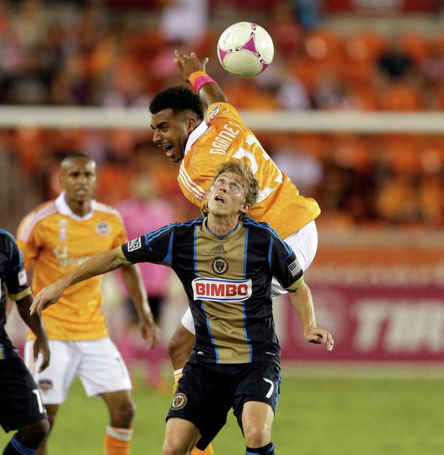 HOUSTON,TX - OCTOBER 20: Giles Barnes #23 of the Houston Dynamo goes up over Brian Carroll #7 of the Philadelphia Union for a header in the second half at BBVA Compass Stadium on October 20, 2012 in Houston, Texas. Houston won 3-1. Photo: Bob Levey, Getty Images / 2012 Getty Images