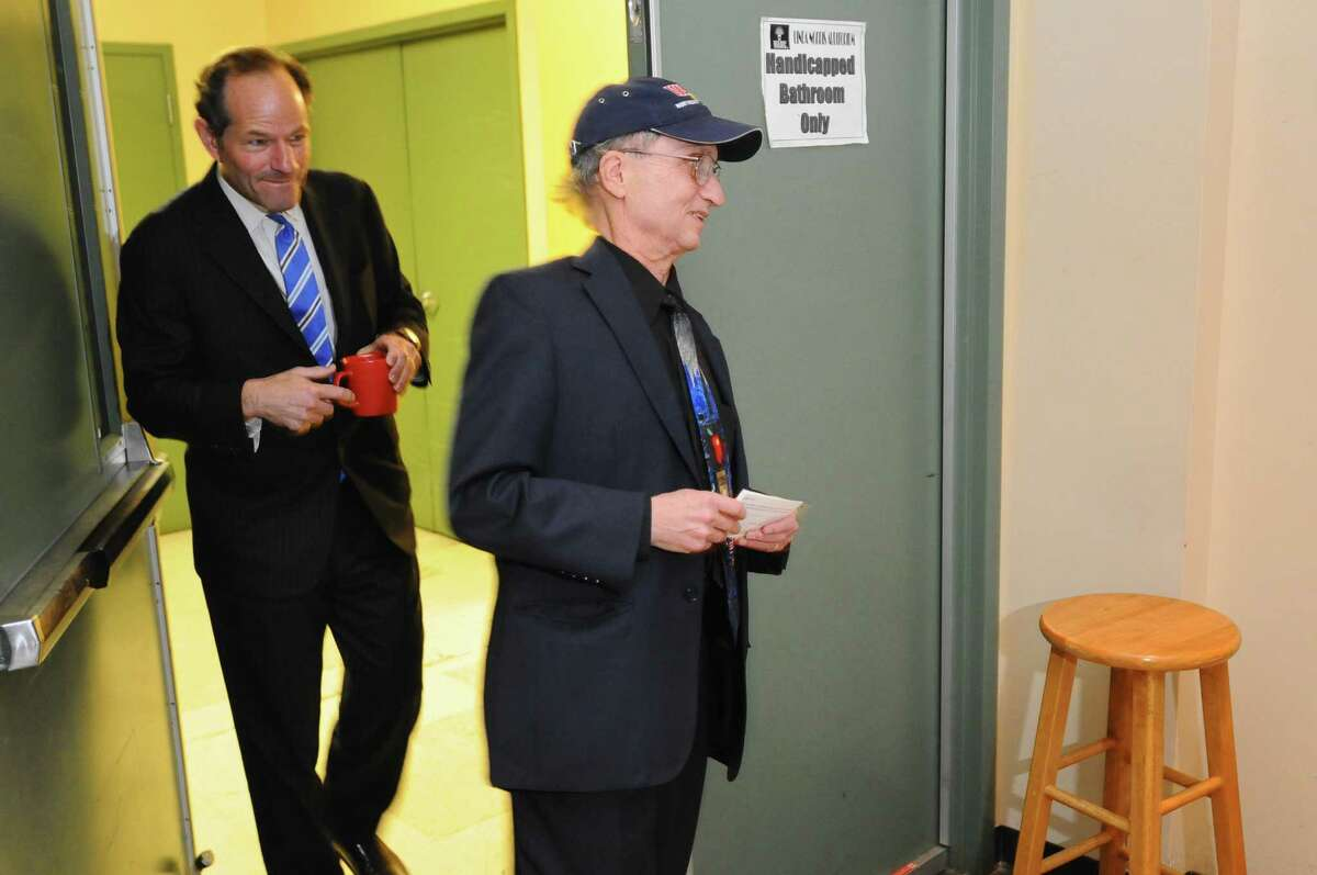 Former New York State Governor Eliot Spitzer and WAMC Northeast Public Radio President and CEO Dr. Alan Chartock, right, enter the Linda Norris Auditorium to tape an interview during Spitzer's first visit to Albany since his abrupt resignation as governor in 2008, on Sunday Oct. 21, 2012 in Albany, NY. (Philip Kamrass / Times Union)